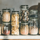 Grains, cereals, nuts, dry fruit, flour, pasta over kitchen counter - PhotoDune Item for Sale