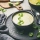 Brussels sprouts vegetable cream soup in black bowls, selective focus - PhotoDune Item for Sale