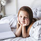 Free Download Portrait of a little girl in the bed reading a book. Activities, hobbies Nulled