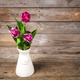 Free Download Vase of natural tulips. flowers on a wooden background Nulled