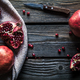 Free Download Ripe pomegranates, napkin and table knife on wooden background Nulled