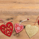 Top view, flat lay of various hearts, wooden background, banner. - PhotoDune Item for Sale