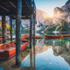 Wooden boats near the house in Braies lake at sunrise - PhotoDune Item for Sale