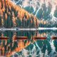 Wooden boats on Braies lake at sunrise in autumn - PhotoDune Item for Sale