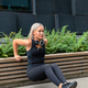 Dedicated Woman Doing Triceps Dips Outdoor in the City - PhotoDune Item for Sale