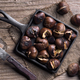 pan full of roasted chestnuts on rustic wood - PhotoDune Item for Sale