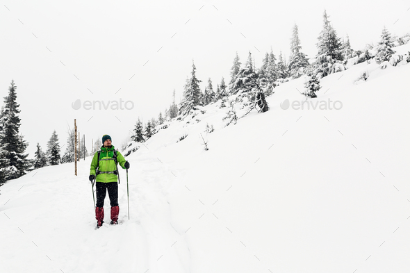Winter hike in white, man and adventure concept - Stock Photo - Images