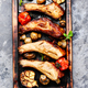 Grilled ribs on cutting board. - PhotoDune Item for Sale