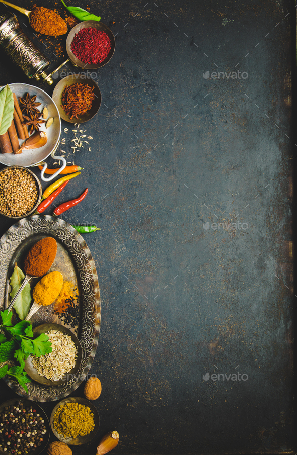 Herbs and spices on dark background - Stock Photo - Images