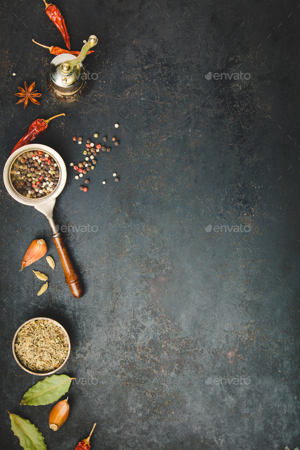 Spices and vintage pepper grinder - Stock Photo - Images