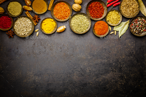 Various bowls of spices over dark background - Stock Photo - Images