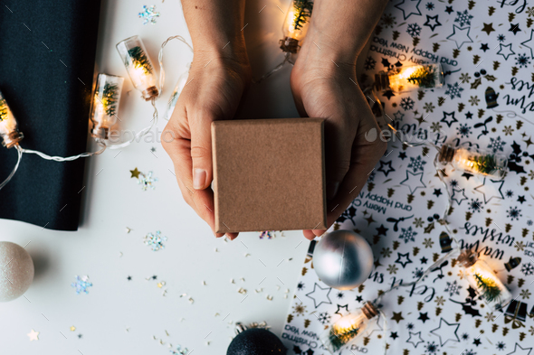 Woman hands holding Christmas presents - Stock Photo - Images