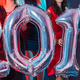 Free Download New Year party concept. Close up of young women holding silver colored numbers 2019 Nulled