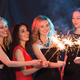 Free Download New year party, celebration and holidays concept - Young cheerful women holding burning sparklers Nulled
