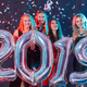 Free Download New 2019 Year is coming. Group of cheerful young women holding silver colored numbers on the party. Nulled