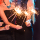 Free Download New year party, celebration and holidays concept - group of friends having fun with sparklers Nulled