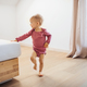 A small girl walking indoors in a bedroom. - PhotoDune Item for Sale