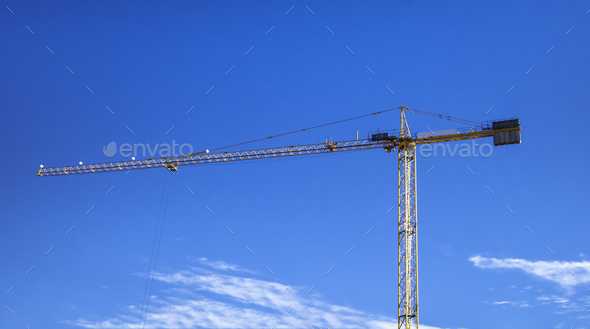 Construction crane Huge crane against blue sky Self-erection crane Tower crane - Stock Photo - Images