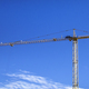Construction crane Huge crane against blue sky Self-erection crane Tower crane - PhotoDune Item for Sale