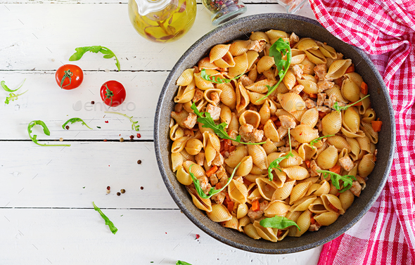Italian pasta shells with meat and tomato sauce. Conchiglie pasta. Top view - Stock Photo - Images