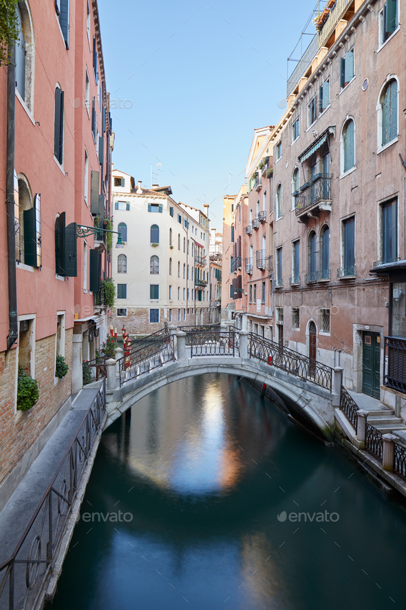 Venice, ancient buildings and calm water in the canal, Italy - Stock Photo - Images