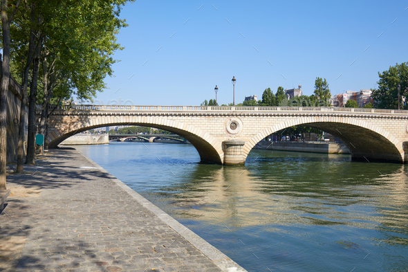 Paris, empty Seine river docks and bridge in a sunny summer day - Stock Photo - Images