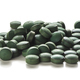 Spirulina Tablets Over White Background - PhotoDune Item for Sale