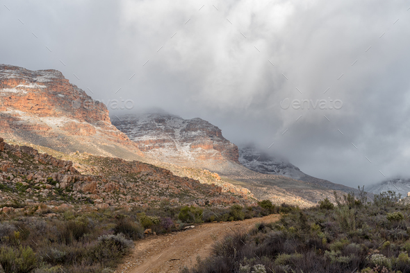 Snow is visible on the mountains at Kromrivier - Stock Photo - Images