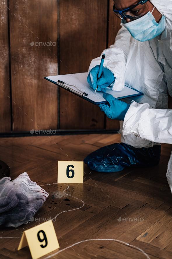 Crime Scene Detective Examining Evidence - Stock Photo - Images