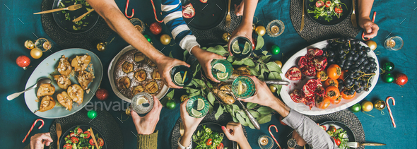 Company of friends gathering for Christmas dinner, wide composition - Stock Photo - Images