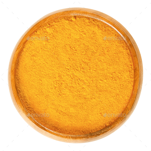 Turmeric powder in wooden bowl over white - Stock Photo - Images