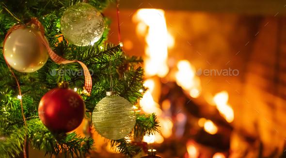 Burning Christmas Tree.Christmas Tree Close Up On Blurred Burning Fireplace Background