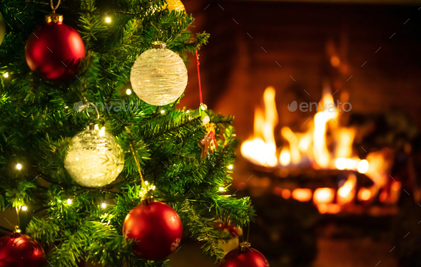 Christmas Fire Place Images.Christmas Tree Close Up On Blurred Burning Fireplace Background