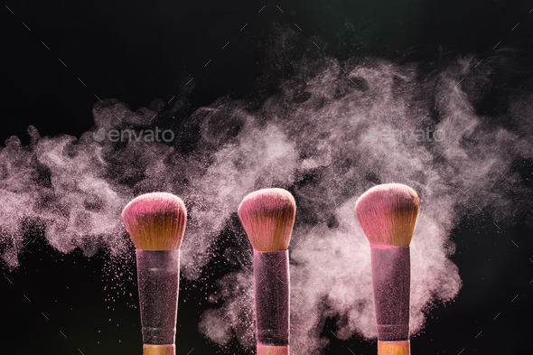 Make up, beauty and mineral cosmetic concept - Cosmetics brush and explosion light pink colorful - Stock Photo - Images