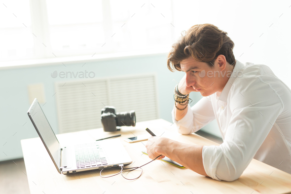 People, working and graphic tablet - young graphic designer in home office working on laptop - Stock Photo - Images