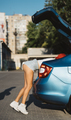 The girl looking something in the trunk of a car - PhotoDune Item for Sale