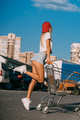 Young, sexy girl posing with a basket in a car park - PhotoDune Item for Sale