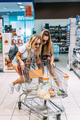 Two young girls have fun at the supermarket - PhotoDune Item for Sale