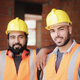 Happy Construction Workers Smiling At Camera In New Building - PhotoDune Item for Sale