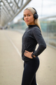 Close-up of Woman in Black Workout Outfit Listen To Music on Headphones - PhotoDune Item for Sale