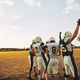 Young American football team celebrating together after a game - PhotoDune Item for Sale