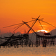 Sunrise with traditional fishing trap in Pak Pra village, Phatthalung, Thailand - PhotoDune Item for Sale