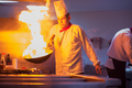 Chef doing flambe on food - PhotoDune Item for Sale