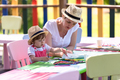 mom and little daughter drawing a colorful pictures - PhotoDune Item for Sale