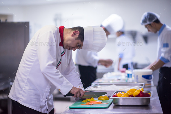 Chef cutting fresh and delicious vegetables - Stock Photo - Images