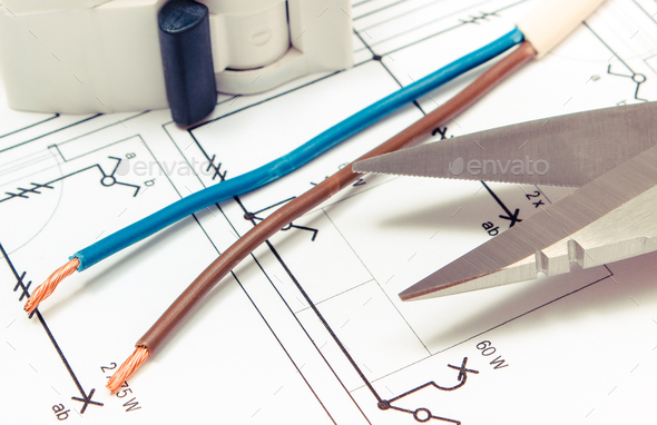 Cable cutter, electric cable and fuse on electrical drawing of house, engineer jobs concept - Stock Photo - Images