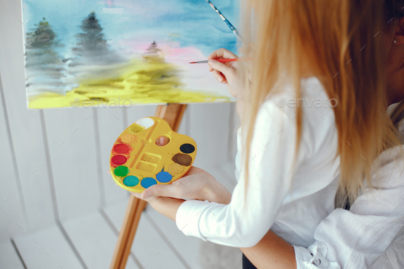 Beautiful mom and daughter are drawing - Stock Photo - Images