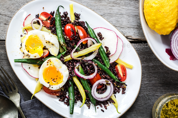 Riceberry with Soft boiled egg,Green bean,Radish and Cherry tomato - Stock Photo - Images