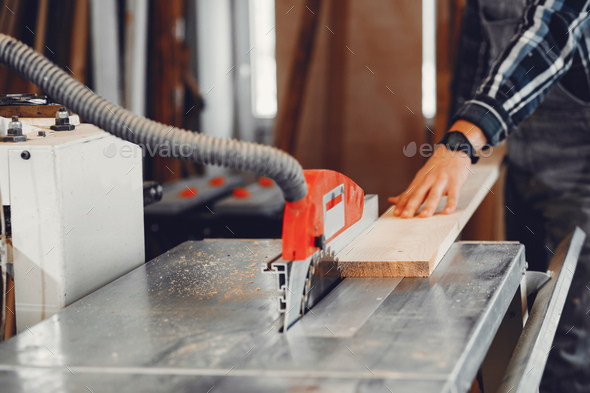 The carpenter works with a tree - Stock Photo - Images