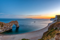 The natural arch Durdle Door after sunset - PhotoDune Item for Sale